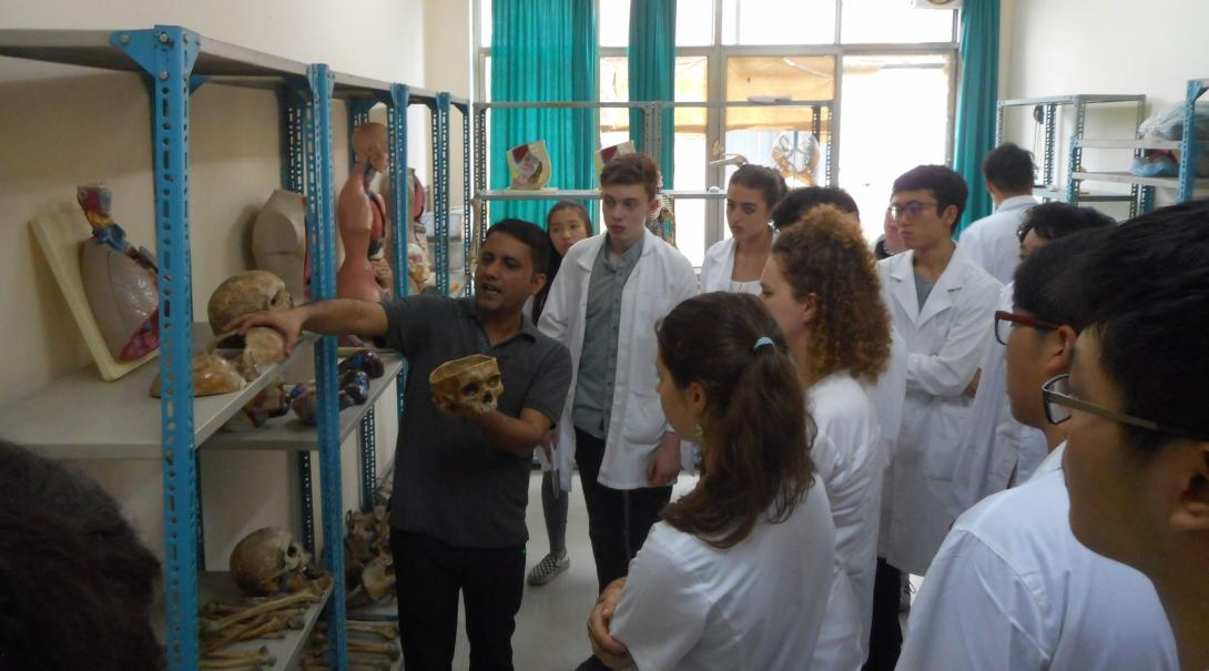 High School Special Medicine volunteers receive an anatomy lesson from a teacher at the Chitwan Medical College